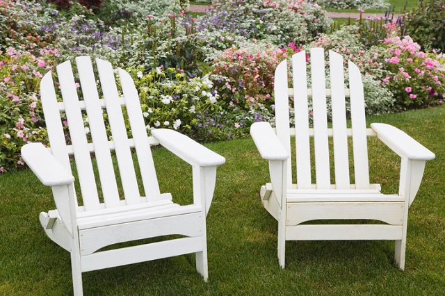 Two adirondack chairs in a garden, Massachusetts