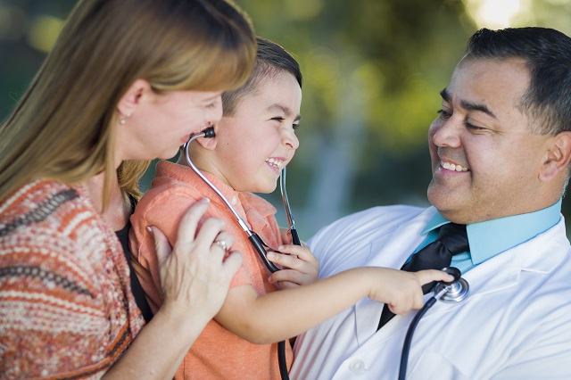 Mixed Race Boy, Mother and Doctor Having Fun With Stethoscope